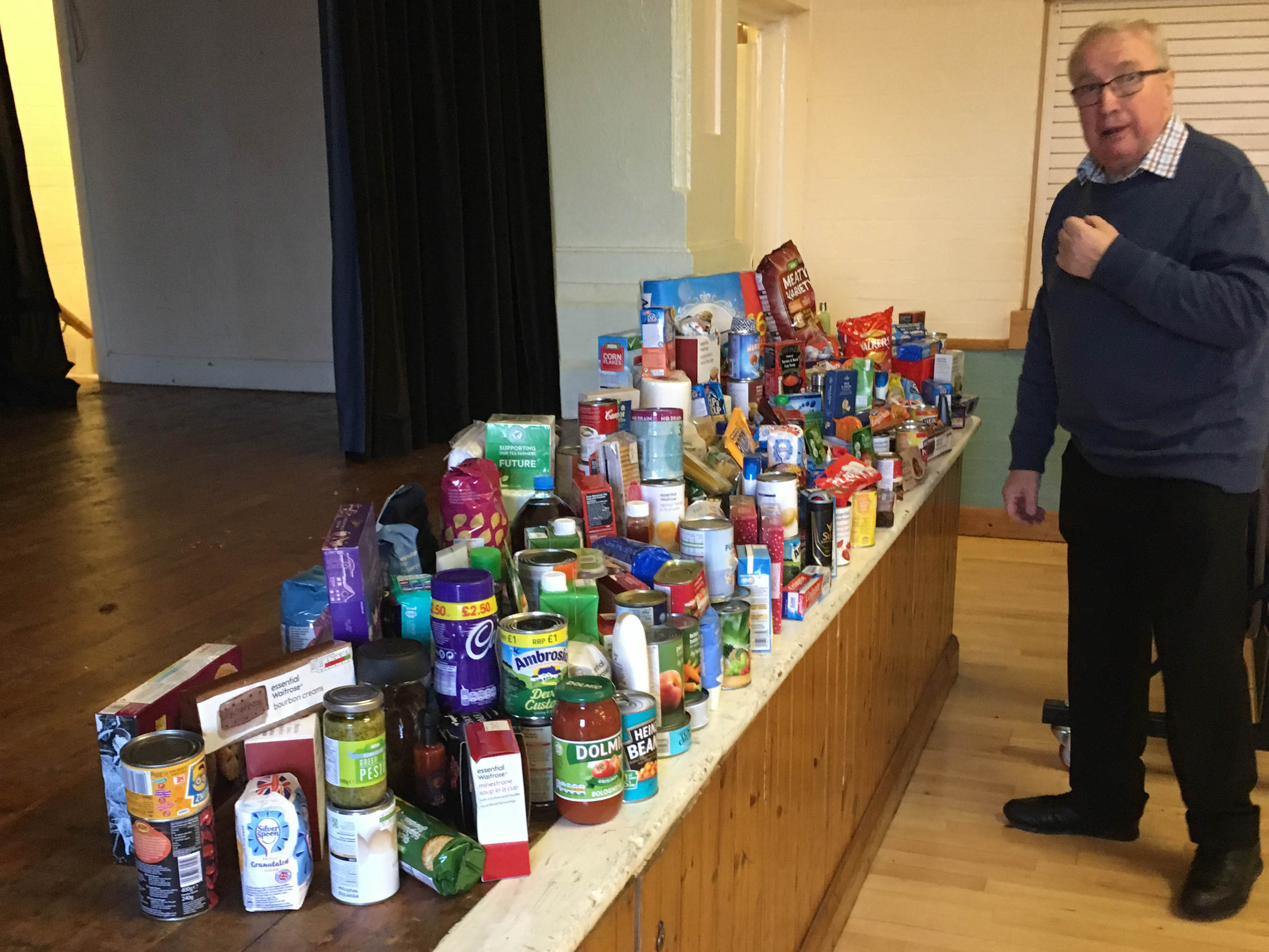 IMG 1558 Gordon Hewer with goods collected Advent Service 1st Dec 2018-1558