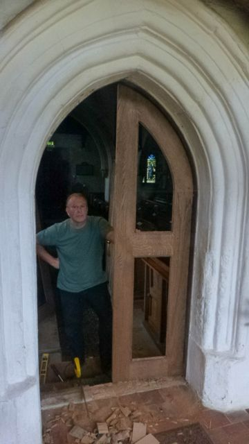 P1030826 r Roland Bailey with new doors at St ippolyts Church 5th October 2015