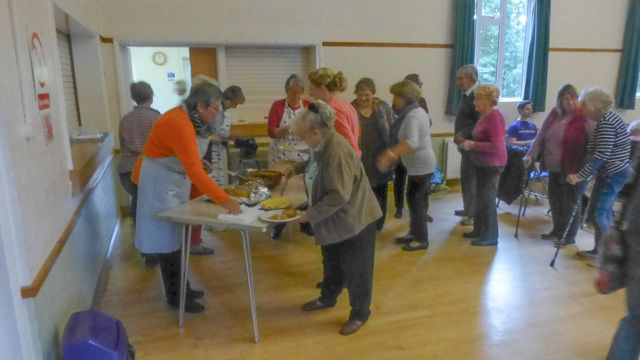 P1030829  R Queuing at St Ippolyts Community Lunch on 7th October 2015